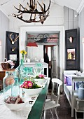 Small shop containing old furniture and vintage and country-house-style home accessories