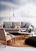 Coffee table and armchair on round sisal rug in front of dog lying on pale grey sofa