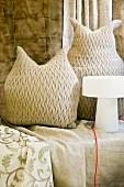 Owl-shaped, woven cushions