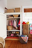 Wardrobe with shoe rack and storage baskets for laundry and toys