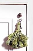 Pom-pom and key on doorknob