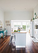 Vintage kitchen with industrial-style stools at central island counter
