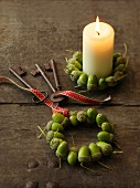 Candle with wreath of acorns