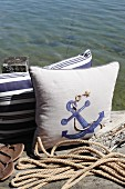 Maritime cushions decorated in classic blue and white with jute yarn and fabric paint