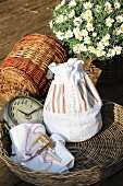 Hand-sewn laundry bag made from white bed linen with patterned fabric inserts and lace trim