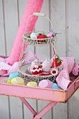 Fruits and cakes hand-crafted from scraps of felt, socks and jersey on wire cake stand
