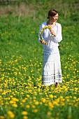 Woman making dandelion wreath