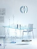 Transparency - plexiglass chairs at glass table and table lamps with glass lampshades below spherical, metal pendant lamp