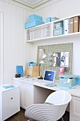 White home office area with country-house-style wood panelling