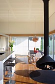 Living and dining room with suspended stove