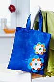 Blue cloth bag with appliqu