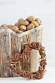 Walnuts in wooden basket and wicker heart