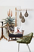 Wooden bench, side table, armchair and picture of yucca