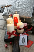 Decoration suggestion: modern Advent wreath of candles on wooden board