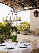 Set table on outdor stone patio