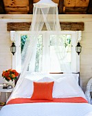 Well made bed with bug netting