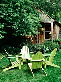 Small cabin with adirondeck furniture abd black labrador