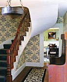 Curved stairway and entrance way with arts and crafts furnishungs in 18th century house