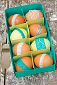 Easter eggs with coloured lace trim in blue paper box