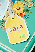 Letters stuck onto hand-crafted gift tag with printed bunny motif