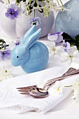 Easter table decoration with china rabbit, flowers & china egg