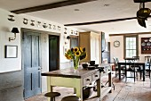 Open-plan, country-house-style kitchen-dining room in restored, historical house