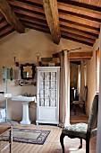 Vintage, attic bathroom in Mediterranean holiday home