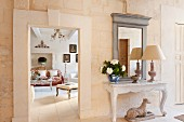 View from foyer in living room of restored, elegant, French country house
