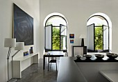 Lounge with open windows, modern artworks and furnishings (Eric Linard art gallery, France)