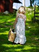 Girl walking with basket