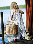 A girl carrying a basket