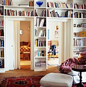 Bookcases fitted around doors with view into adjacent rooms