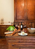 Food and wine on wooden table in kitchen