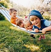 Four children in hammock in garden