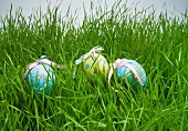 Decorative easter egg hiding in grass