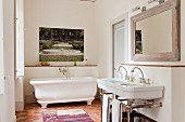 A traditional tomette tiled floor in white bathroom with artwork by Martini Maggi