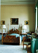 Antique bed with corner posts and dressing table in grand bedroom