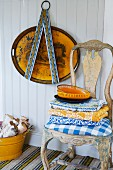 Antique chair with modern, gingham seat cushion