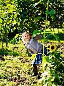 Girl in autumnal garden