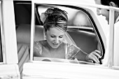 Bride alighting from car