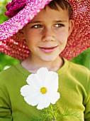 Portrait of a boy wearing a lady?s hat, Sweden.