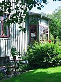 Gable of a green house in a garden, Sweden.