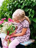 Scandinavian girl with pink flowers, Sweden.