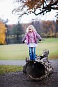 Girl balancing on log