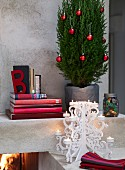 Christmas tree beside stack of books