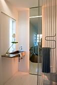Elegant designer bathroom with sink and floor-to-ceiling mirror