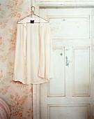 Shirt on hanger hung on doorframe