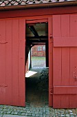 An Open Door on a Barn.