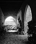 Arched walls with cobblestone flooring (B&W)