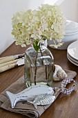 White hydrangeas in glass bottle